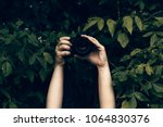 Womans Hands Holding Camera Snapping - Fine Art prints