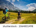 mountain cycling couple with... | Shutterstock . vector #1064831498