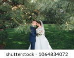 a handsome groom and a young... | Shutterstock . vector #1064834072