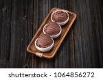 chocolate ice cream with bowl... | Shutterstock . vector #1064856272