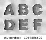 alphabet ripped paper on... | Shutterstock .eps vector #1064856602