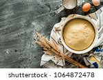 baking   raw dough  pastry  in... | Shutterstock . vector #1064872478