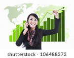 Businesswoman expresses her success while using her cell phone. shot over global business chart background - stock photo
