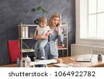 happy mother working at office... | Shutterstock . vector #1064922782