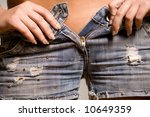 young girl unzipping her jeans | Shutterstock . vector #10649359