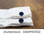 cufflinks with shirt on the... | Shutterstock . vector #1064953532