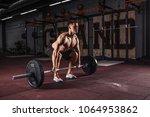 muscular men lifting deadlift... | Shutterstock . vector #1064953862
