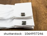 cufflinks with shirt on the... | Shutterstock . vector #1064957246