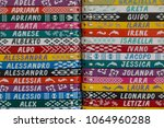 colorful bracelets with names ... | Shutterstock . vector #1064960288