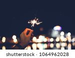 motion blurred sparklers in... | Shutterstock . vector #1064962028