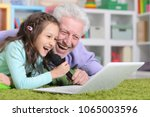 happy grandfather and child... | Shutterstock . vector #1065003596