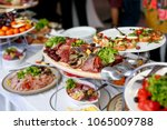 a lot of food and snacks on...   Shutterstock . vector #1065009788