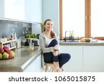 woman in the kitchen. cooking... | Shutterstock . vector #1065015875