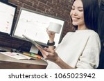 business woman holding cup of... | Shutterstock . vector #1065023942