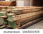 oak planks ready for drying.... | Shutterstock . vector #1065031925