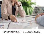 administrator team analyze data ... | Shutterstock . vector #1065085682