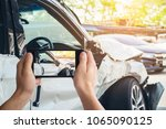 a man photographed his vehicle... | Shutterstock . vector #1065090125