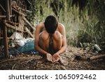 selective focus. hands poor... | Shutterstock . vector #1065092462