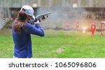 woman in practice shooting gun...   Shutterstock . vector #1065096806