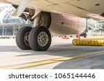 aircraft tires of plane | Shutterstock . vector #1065144446