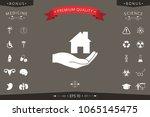 hand holding home | Shutterstock .eps vector #1065145475