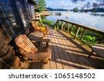 muskoka chairs sitting on a... | Shutterstock . vector #1065148502