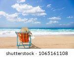woman sitting on the wild beach ... | Shutterstock . vector #1065161108