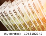parts of hundred euro bills are ... | Shutterstock . vector #1065182342