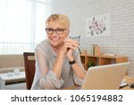happy aged business lady... | Shutterstock . vector #1065194882