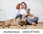 a happy married couple with... | Shutterstock . vector #1065197642