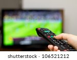 watching soccer game on tv | Shutterstock . vector #106521212