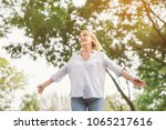 happy woman in spring or summer ... | Shutterstock . vector #1065217616