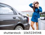 woman stand near scratched auto.... | Shutterstock . vector #1065234548