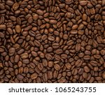roasted coffee beans background | Shutterstock . vector #1065243755