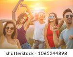the five friends dancing with a ... | Shutterstock . vector #1065244898