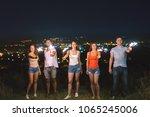 the friends hold firework... | Shutterstock . vector #1065245006
