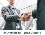 businessman making handshake... | Shutterstock . vector #1065248846