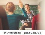 teacher in the classroom hands... | Shutterstock . vector #1065258716