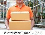 delivery man with parcel. | Shutterstock . vector #1065261146