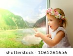 the child is looking in the... | Shutterstock . vector #1065261656