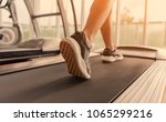 Small photo of Exercise treadmill cardio running workout at fitness gym of woman taking weight loss with machine aerobic for slim and firm healthy in the morning.Show of running shoes, rubber floor, softness