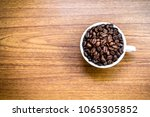 coffee beans in white cup on... | Shutterstock . vector #1065305852