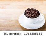 coffee beans in white cup on... | Shutterstock . vector #1065305858