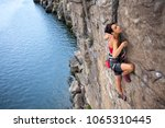 the girl climbs a climbing... | Shutterstock . vector #1065310445