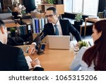 family lawyer shows young... | Shutterstock . vector #1065315206