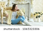 beautiful teen girl sitting on... | Shutterstock . vector #1065323306