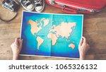 woman holding map travel... | Shutterstock . vector #1065326132