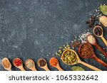 spices and herbs over black... | Shutterstock . vector #1065332642