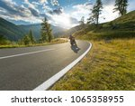 motorcycle driver riding in... | Shutterstock . vector #1065358955