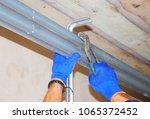 onstruction contractor repair... | Shutterstock . vector #1065372452